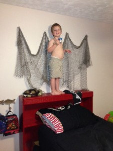 "Callum says ""Cheese!"" for the camera when busted ""redecorating"" his bedroom."